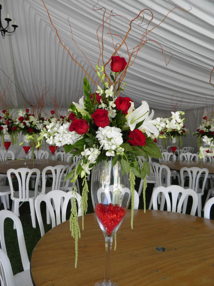 Champagne glass centerpiece flowers i have done