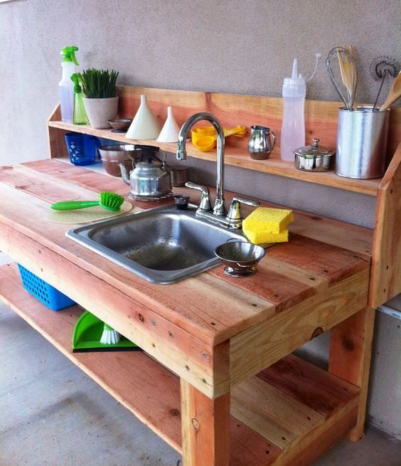 A mud kitchen, as a kids playhouse, provides learning opportunities including sensory, imaginative, creative, exploratory play and enjoy nature.