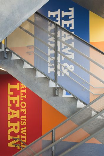 Environmental graphics designed for Achievement First charter school in Clinton Hill, Brooklyn. Design by Paula Scher.