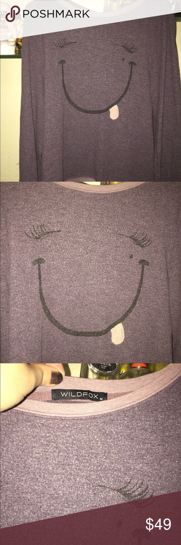 Smiley Wildfox Saks off 5th jumper Super cute purple smiley Wildfox jumper in good condition. The color is closer to the 2nd two than the 1st one Wildfox Tops Sweatshirts & Hoodies