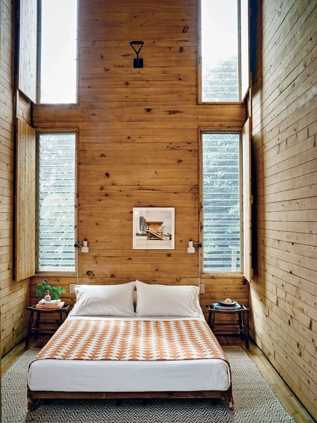 The master bedroom of a Fire Island home with a double-height ceiling.