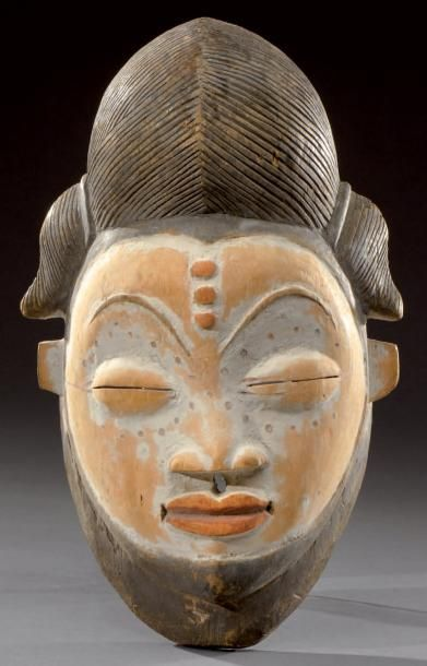 Punu. (Gabon) dance mask polychrome partially covered with kaolin. Early twentieth century Wood. H: 28 cm
