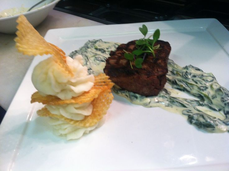 From our New Year's Eve 2014 Prix Fixe Menu! Filet of Beef, Creamed Spinach Balls, Potato Napoleon, Membrillo Chutney