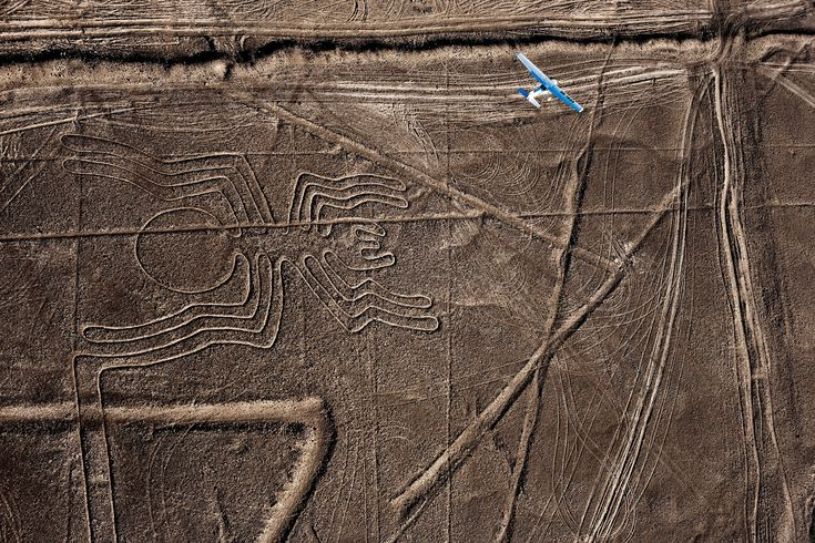 Picture of plane flying over spider-shaped Nasca Lines in Peru