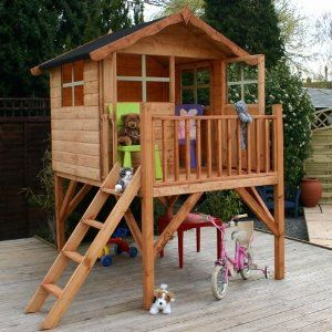 Outdoor playhouse on stilts for kids. Rock bed underneath, slide?