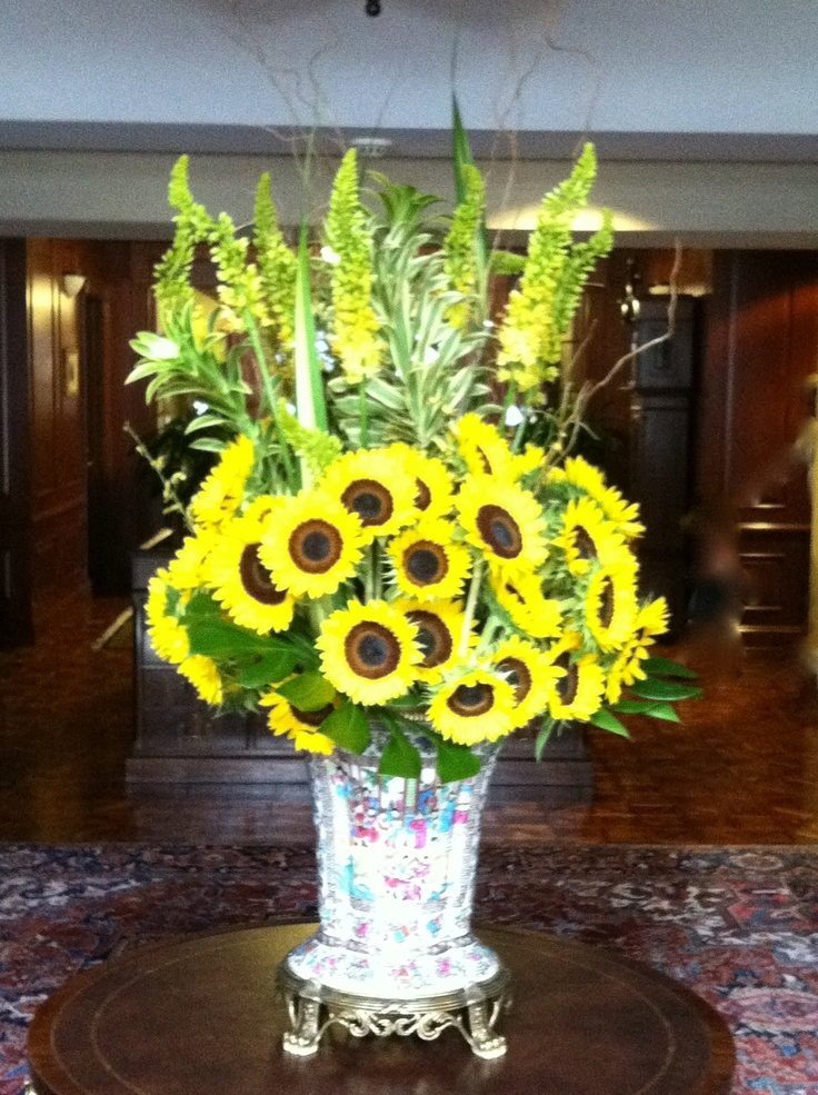 Bright cheerful sunflowers are sure to brighten any lobby.