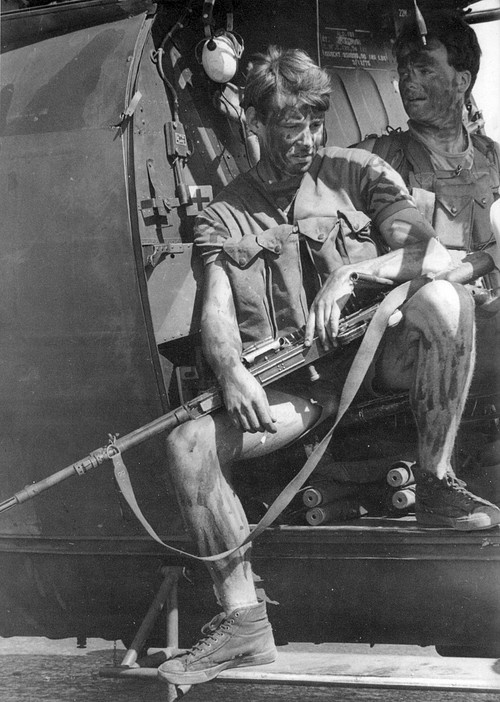 Rhodesian soldier during the Bush War, FN MAG in the back of an Alouette.
