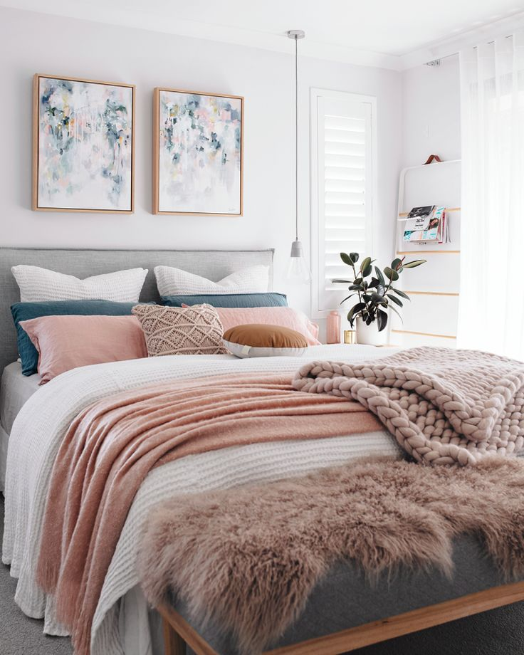 MasterKateFisher blue, pink, and white cozy pastel bedroom with knit blanket and a green plant
