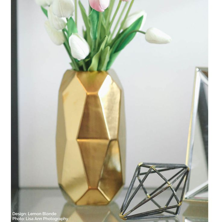 Looking for gold wedding decorations? Check out this unique Maven ceramic cylinder vase with an oval shape. This interesting gold geometric flower container will make a chic, modern DIY centerpiece! -