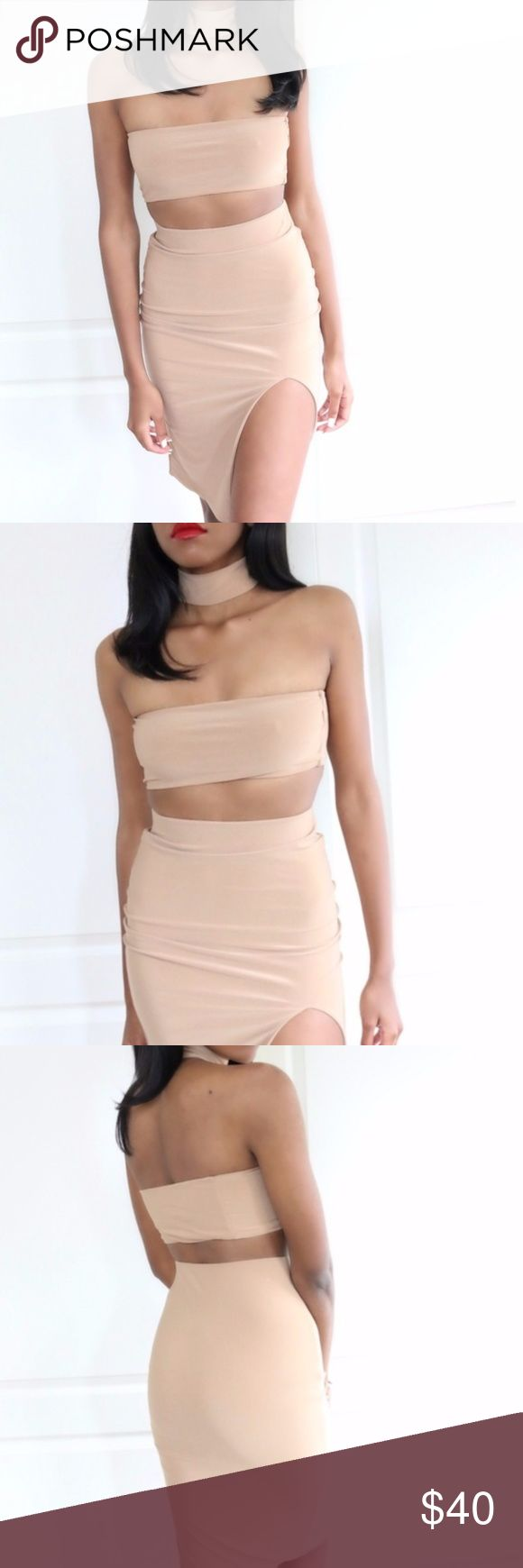 "Bianca Choker Neck 'Three Piece' Set **Small snag on front side of bandeau top.    Super sexy three-piece set! Doubled-Lined. Form fitting. Includes the choker, bandeau, and skirt.  The choker has a two-button closure located in the back. Color: Camel. NOT see through material, and stretches very well!   Material:  96% Poly 4% Span  Measurements:   Top: L (Pit to Pit 14"")   Bottom: Length: 26"" L (Waist 26.5"")  Model Measurements: Height 5'8"", Chest: 32B, Waist 25"", Hips 35"" Jaded Affairs…"