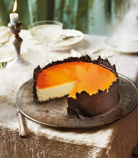 Orange cheesecake with oreo crust and Aperol spritz. Aperol is bright orange liquor. Prosecco is Italian wine. Most Liquor Store carry them . Castor is just extra fine sugar