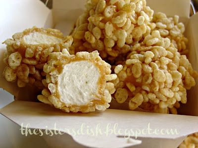 Marshmellows covered in carmel with condensed milk and rice crispies on the outside
