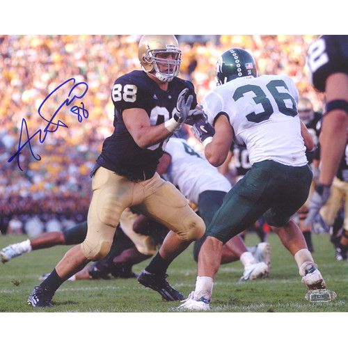 Anthony Fasano Notre Dame Blocking vs. Michigan State Horizontal 8x10 Photo - The Dallas Cowboys selected Anthony Fasano in the second round of the 2006 NFL Draft and in his rookie season with the Cowboys the tight end caught 14 passes for 126 yards and an impressive average of nine yards per catch. Fasano a New Jersey native joined the Cowboys after a solid career at Notre Dame during which he pulled down 92 passes for 1112 yards and eight TDs. Anthony Fasano has hand signed this 8x10…
