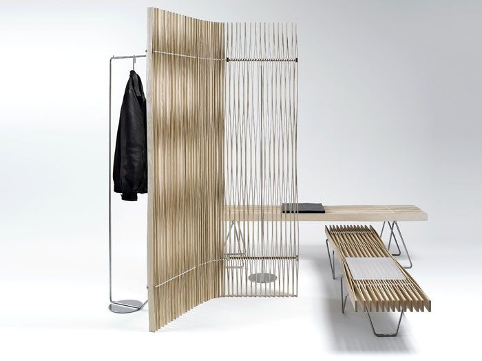 "Paraventplus, by Swiss designers Röthlisberger, is marketed as ""a flexible room divider and coat rail in one."" http://vurni.com/paraventplus-coat-rail-room-divider/ SEE ALSO: http://vurni.com/freestanding-shelving-systems-roomdividers/"