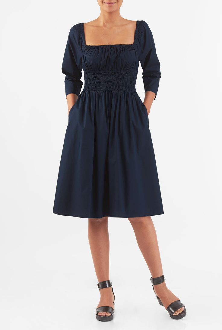 Our cotton poplin dress is elasticated at the wide square neckline and wide banded waist for a blousony boho silhouette.