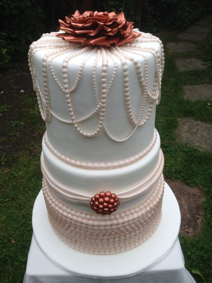 Pearls and copper rose