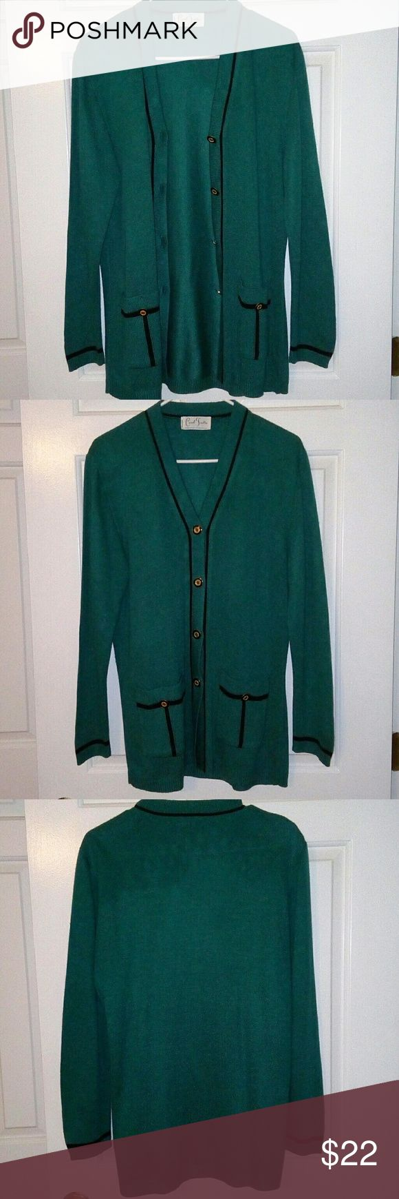 Retro Cardigan Carol Trotta teal cardigan. Thick fabric that is like new. Has four buttons to button it and two front pockets each have one button to close. Black stripe starting at the band going up to the collar and back down. Also has black on the pockets as seen in picture 4. Carol Trotta Sweaters Cardigans