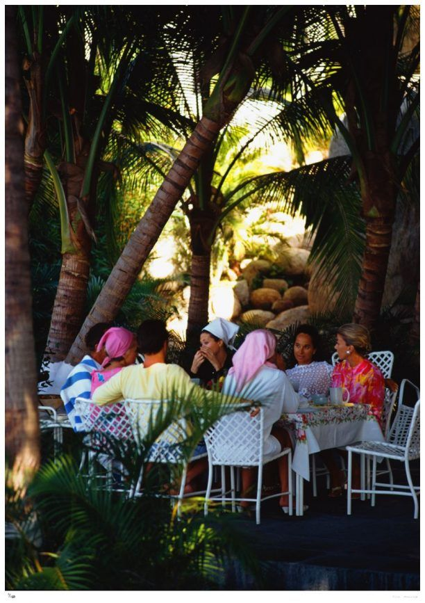 'Oberon's Lunch' by Slim Aarons   available as an Open Edition or Limited Edition Estate Stamped Print (edition size 1/150).   Film star Merle Oberon (1911 – 1979) and lunch guests at her villa, La Consentida, Acapulco. The star is second from the right facing the camera. A Wonderful Time – Slim Aarons   Available to order online in various sizes & frames at www.GALERIEPRINTS.com