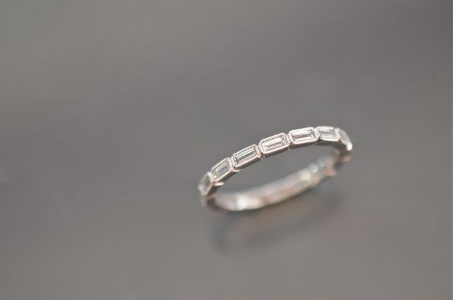 LOVE this wedding band of all baguettes! Would look great with an eterntity band of round ones too. would highlight the emerald cut