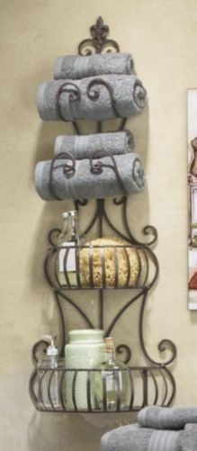 Master bath: you can use a wine rack similar to this to roll up towels.  Use colorful towels to accent.