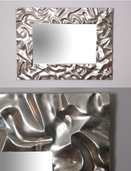 Silver sand ripple mirror. Part of our Nature Collection, this wall mirror / sculpture is inspired by sand ripples at low tide.  This mirror works well above our console tables or as a hall mirror. Hand made with a silver metal leaf and antique finish, absolutely gorgeous!