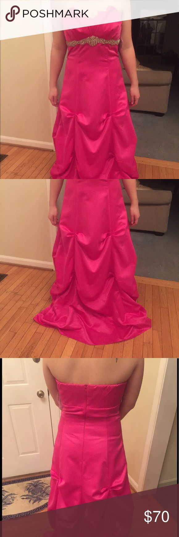 """Fuschia prom ball gown I bought this for prom a few years ago but I ended up not going so it has never been worn, still has the tags. Orig $139.99. It is sized as an 11 however I would say the sizing runs small because I usually wear a 6/8. I am 135 lbs. you can see the dress is too long for me, I am only 5' 2"""" so if you are a little taller and/or wear tall heels it won't need to be hemmed. Dresses Prom"""