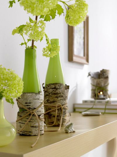 painted wine bottles wrapped in birch bark
