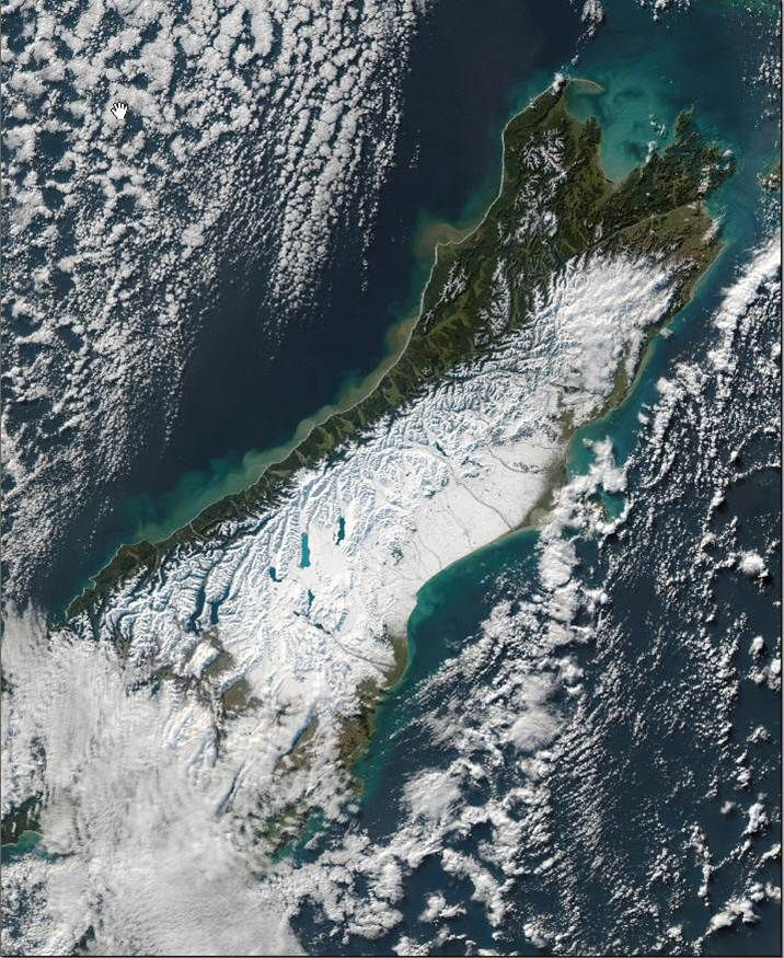 The South Island, New Zealand, from space. Canterbury is covered in snow from the mountains to the sea. June 2006