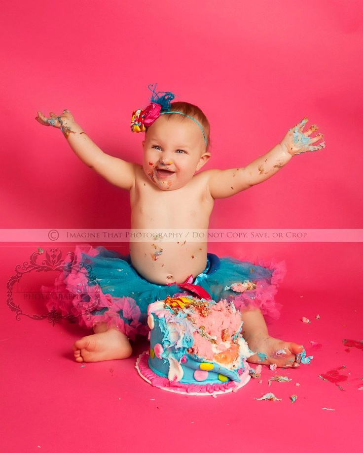 Fantastic smash cake photoshoot!!  Not sure of the background color.