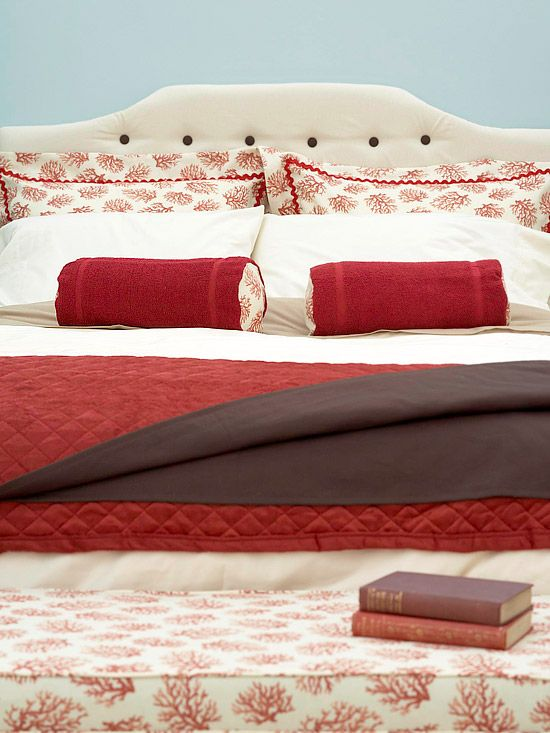 Dressed Bed  Use coordinating fabrics to add flair to the bed. Pillow shams, bolster pillows, and a bench cushion all get a kick from red-and-white fabric. Crisp white linens keep the rest of the bedding affordable.