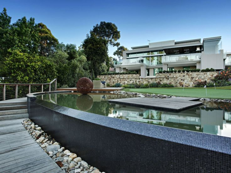 Eco Outdoor Crackenback free form natural stone walling used as first floor building facade behind infinity pool edge, Focal Point Design and The Garden Company. | Eco Outdoor | livelifeoutdoors | Free form walling | Outdoor design | Garden design | Outdoor paving | Outdoor design inspiration | Outdoor style | Outdoor ideas | Garden ideas | Outdoor luxury | Natural stone flooring and walling | Retaining wall | Stone veneer | Stone walling | Stone cladding | Pool ideas
