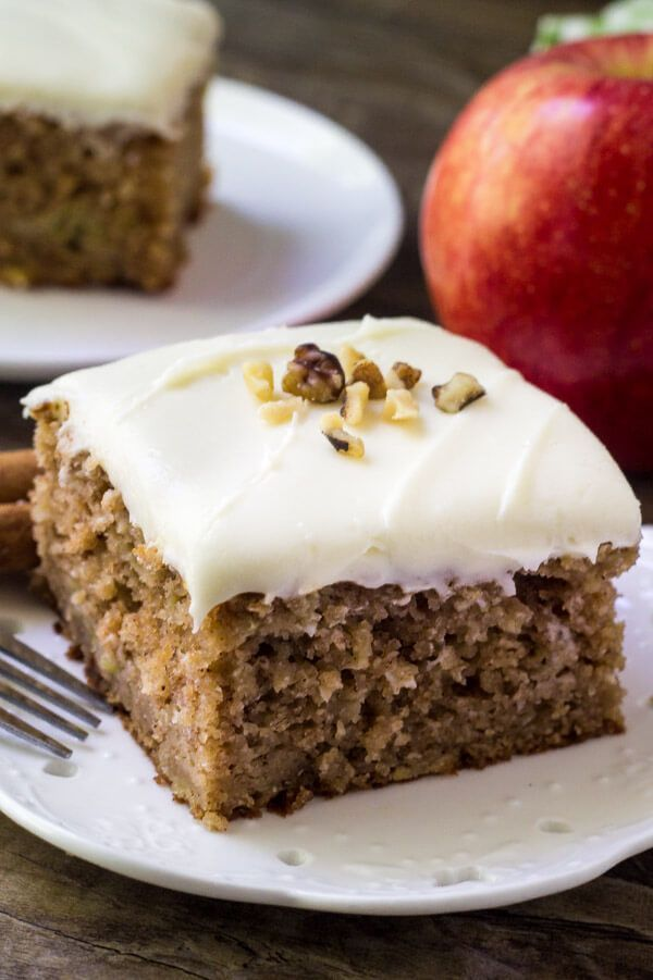 Apple spice cake with cream cheese frosting is packed with flavor and perfectly moist. Topped with fluffy cream cheese frosting & perfect for fall.