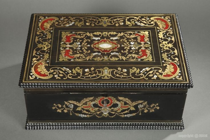 A mid-19th century wooden casket inlaid with mother-of-pearl