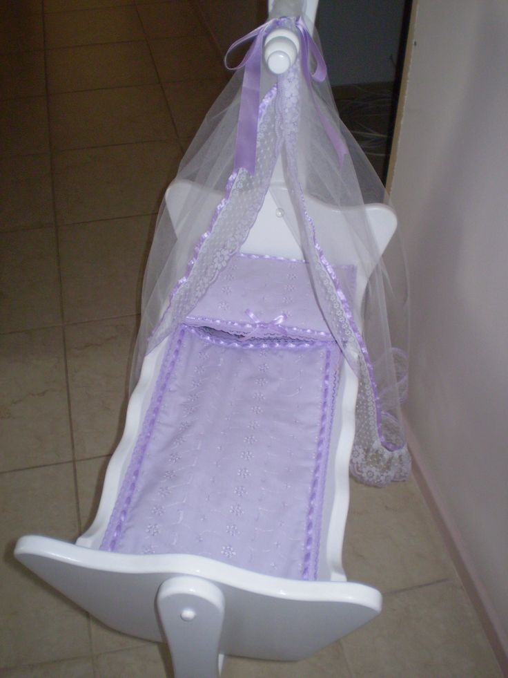 Dolls cradle made by Peter.  Mattress, pillow, covers, sheets, blanket and net made by Janine!