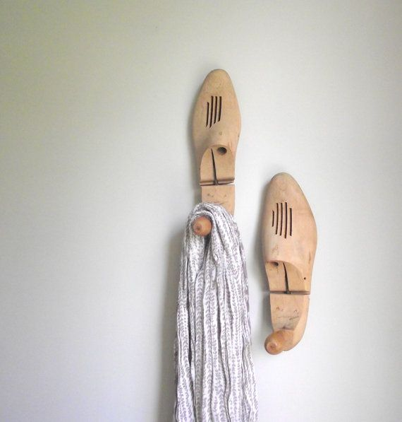 So much better than traditional wall hooks! Wooden Shoe Stretchers Vintage Pair of Wood Shoe Keepers from gazaboo on etsy