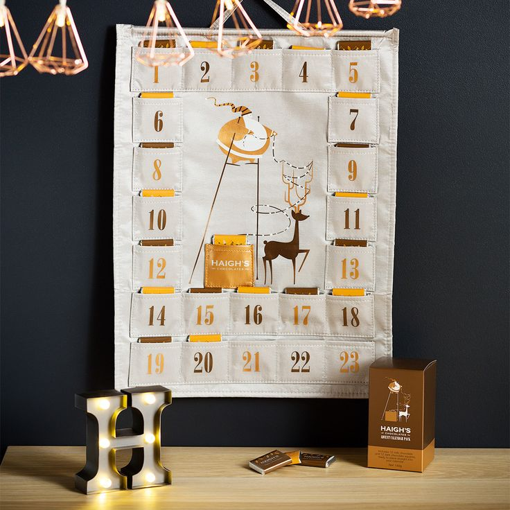 Count down the days until Christmas with the Haigh's Advent Calendar! Fill this fabric Advent Calendar with your own selection of Haigh's treats or purchase the accompanying Advent Calendar Pack with milk and dark chocolate squares.