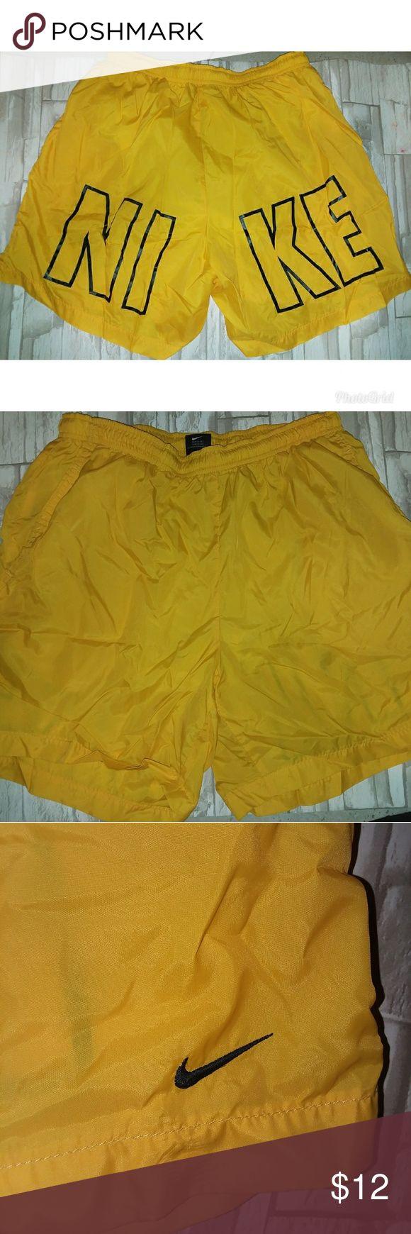 {Nike} yellow swim shorts Men's Nike swim shorts Yellow Nike on back and Nike symbol on front  Size large   Excellent condition Nike Swim Swim Trunks