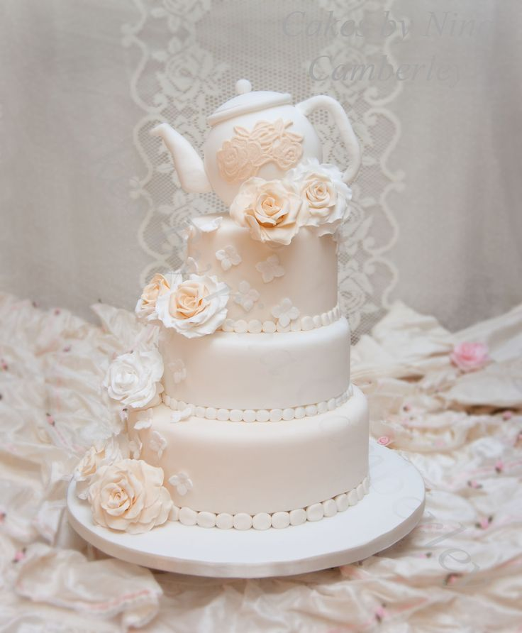 This is a new original design by Cakes by Nina, this was originally designed by Cakes by Nina in 2012 perfect for those afternoon tea weddings love this cake so much and still going strong/