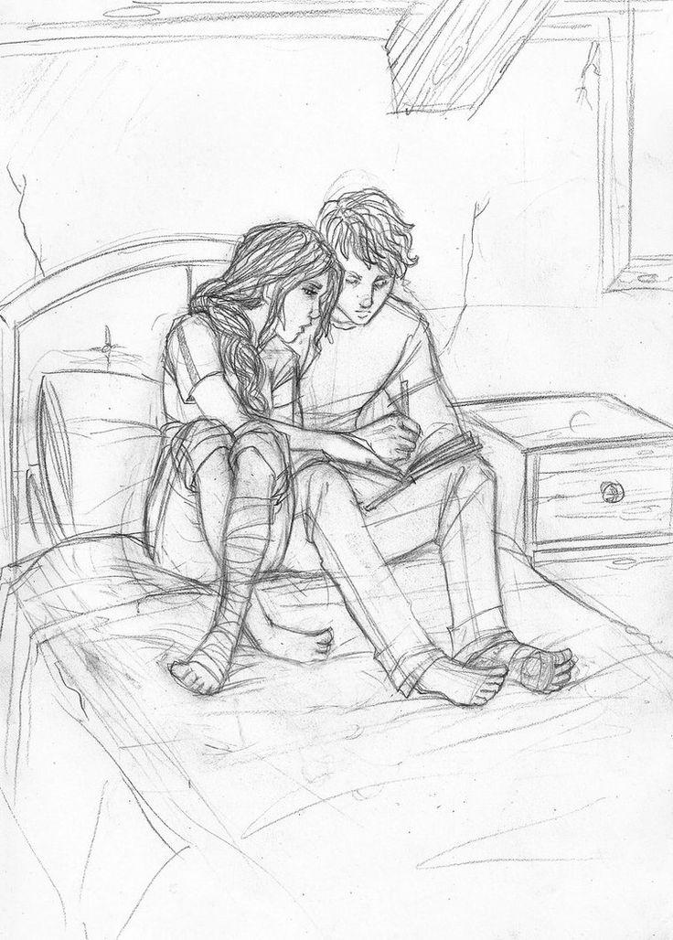 Peeta and Katniss writing in Katniss' family book