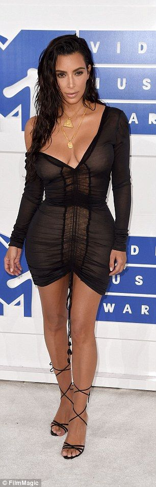 Waves for days: Kim smoldered in sexy, undone hair and a dress we're betting…