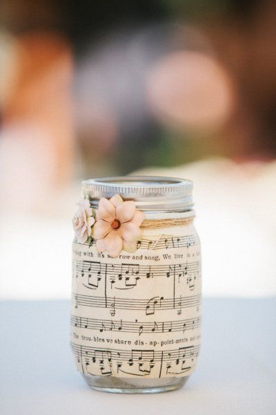 Sheet music on mason jars. Light a candle inside at night, and the music glows.