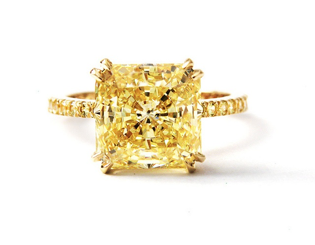 Handmade 5.6 carats radiant-cut canary diamond solitaire ring in 18K yellow gold, featuring double-claw prong work and micro-pave canary diamonds in the band.