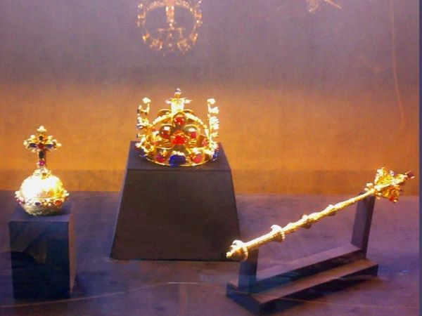 Czech Republic (Bohemia): The crown jewels of the Czech Republic include the Crown of Saint Wenceslas, a royal orb, a scepter, the coronation vestments of the Bohemian kings, the gold reliquary cross, and St. Wenceslas' sword. The crown is 22-carat gold and has four vertical fleurs-de-lis. It's decorated with rubies, sapphires, emeralds, and pearls
