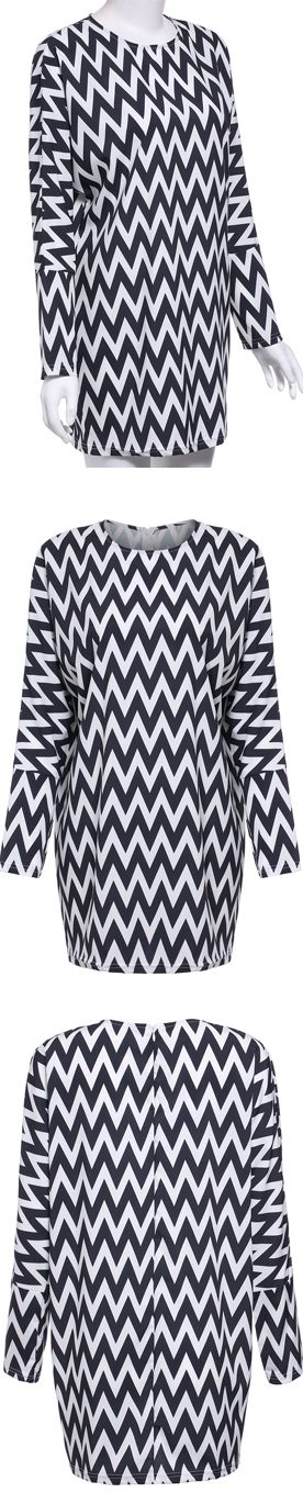 This long sleeved shift dress features black and white geometric pattern print on its wholebody. Its eye-catching look and flattering design render it versatile enough to suit weekend street style and workweek sophistication alike. Bold geometric graphic design lends endless wear options no matter how you pair with it.