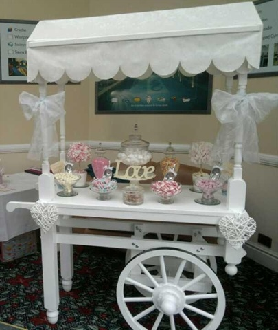 awesome display for your candy buffet and sweet station.  this cart is totally awesome.    I actually have one and it is a flower cart with 3 levels.  I think I will paint it white.  It will fit every type event.