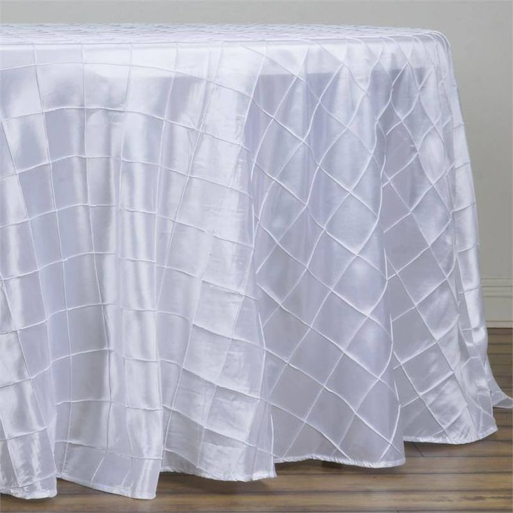 "White Pintuck Tablecloths 108"" Round - Pintuck is actually a fold of fabric that is stitched intricately to hold it in a place, very much like a pleat. These lovely pleats impart a decorative effect to the fabric by fashioning a visual line at a chosen point. They effortlessly bridge vintage and contemporary styles to create a majestic new classic look. If you do not want your celebration to blend in with other weddings, birthdays, and anniversaries, try our premium quality pintuck…"