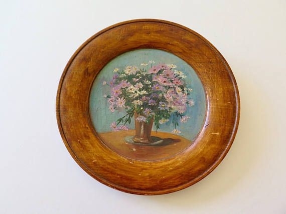 A very sweet small painting on solid wood, apparently it is one piece of carved wood. The wood is a warm honey brown, the pink, light purple and white flowers are painted on a light blue background. A charming little painting that would look great in a country chic or shabby chic home decor. Diam: 9.2 inches (23,5 cm). Please do not hesitate to contact me for further information or pictures.  SHIPPING COSTS vary according to the destination and are not always exact based on the tarifs of the…