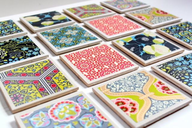 hand made coasters using scrapbook paper, ceramic tiles, felt for bottoms and modpodge.