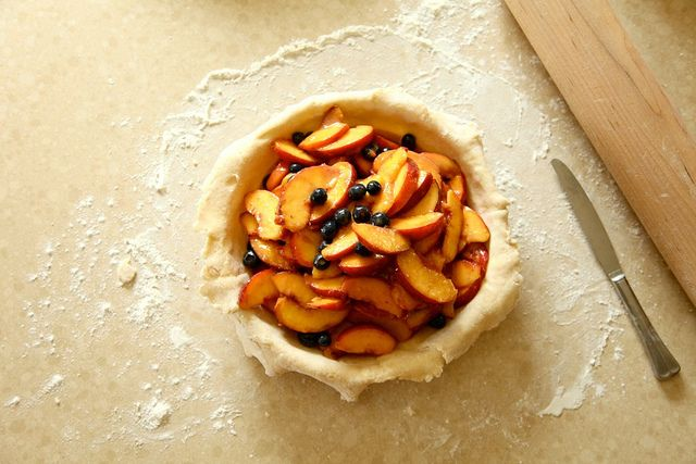 Sunday baking project: homemade peach and blueberry pie. We're thinking a scoop of vanilla ice cream would be just the perfect finishing touch.