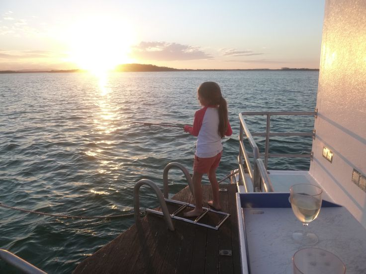 Fishing! She might not have hooked onto something yet, but what a beautiful way to finish an afternoon! #fishing @coomerahouseboats visit www.coomerahouseboats.com.au
